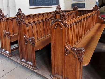 marys: OXFORD - JULY 2013:  Carved wooden pews at St. Marys, the medieval university church, and commemorative plaques for martyrs and donors, as seen in Oxford circa 2013.