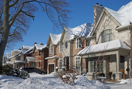 suburban street: suburban street on a sunny day after a snow storm Editorial