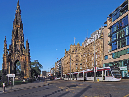 EDINBURGH - SEPTEMBER 2016:  Sir Walter Scotts monument and Princes Street, with a sign to the train station named after one of his fictional characters, as seen in Edinburgh circa 2016. Editorial