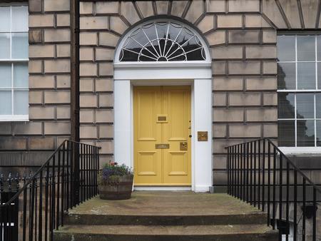 yellow door of old stone building