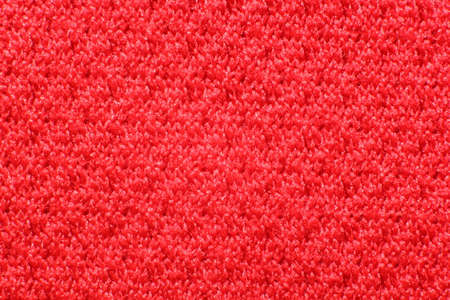 polyester cationic texture material red synthetic fabric macro elastic band background closeup