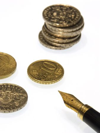 A pen and a few coins isolated from white background. Stock Photo - 329341