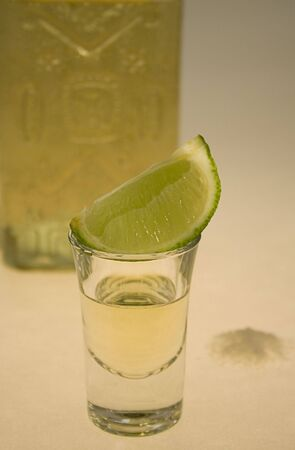 distill: Tequila glass and lime segment