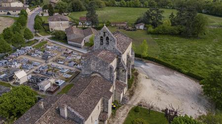 Aerial view of a church and cemetery in the French countryside, Rimons, Gironde, France