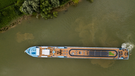 Aerial top down view of tourism motorboat on river garonne, Bordeaux Vineyard, Gironde. Stock Photo