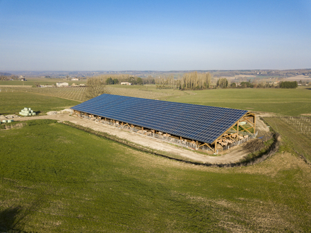 Aerial view of solar panels on a cowshed