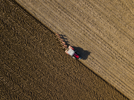 Aerial view, Tractor plowing fields, preparing land for sowing, Gironde, France