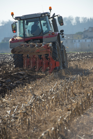 Tractor plowing fields, preparing land for sowing, Gironde, France