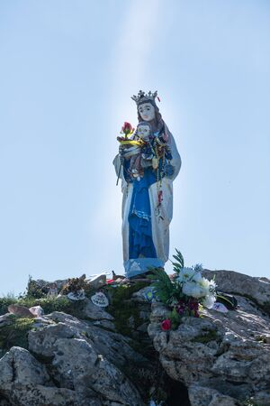 Statue of virgin mary on top of high cliff, Basque country, France, Europe