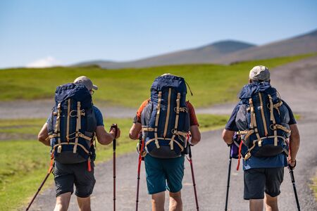 Pilgrims with backpack walking the Camino de Santiago in Pays Basque, France, Europe