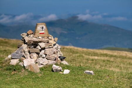 Cairn, Pile of stones on a trail in the Basque Country, France