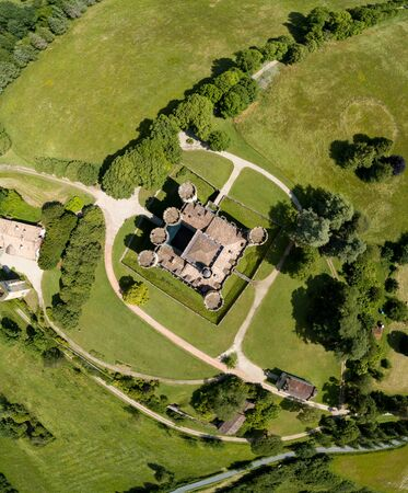 Aerial view of ancient fortified castle of Chateau de Roquetaillade in sunny summer day, Mazeres, France