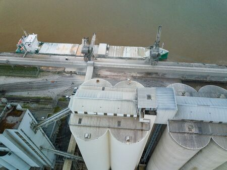 Aerial view of a maize loading operation in a cargo ship