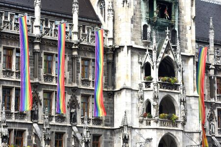 Rainbow-flags at Munich town hall while csd-parade - The CSD parade is a political demonstration and a colorful parade that takes place annually in Munich. It is committed to the equality of gays and lesbians.