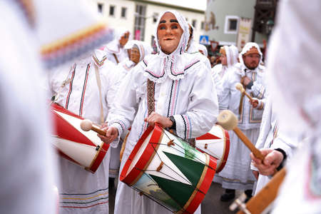 Carnival in Salzkammergut - The drum woman is a figure that appears in groups in the carnival in the Ausseerland in Styria. All drum women are traditionally male and wear female masks and a predominantly white robe, which can also be seen as a night robe. Editorial