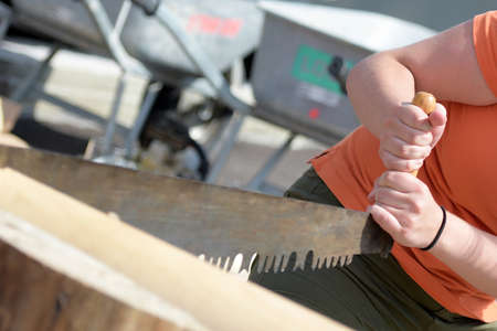 A woman with a wood hand saw Editoriali