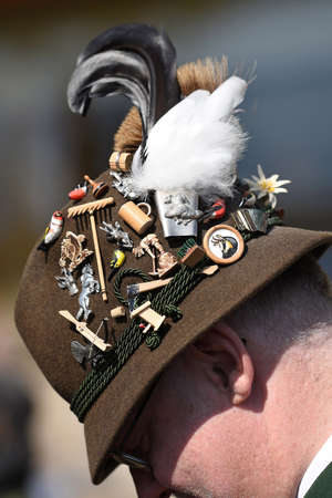 Typical alpine hat in the Salzkammergut with many badges and