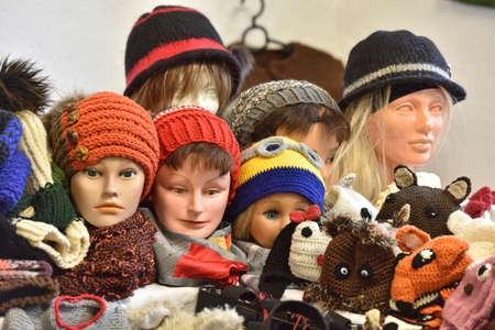 Hoods and hats on the heads of mannequins