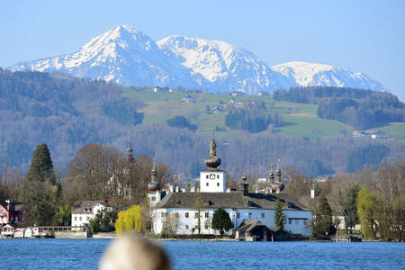 The Ort Castle at Lake Traunsee in Gmunden with snow-capped mountains in the background (Salzkammergut, Gmunden district, Upper Austria, Austria) Editoriali