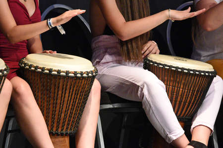 Some girls drumming Editoriali