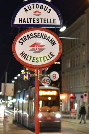Vienna has a large network of public transport - here a tram stop and bus stop at night. Editoriali