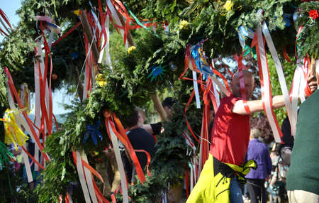 Maypole installation in Austria, Europe - A maypole is a decorated tree or trunk that will be placed in Austria on May 1 (usually April 30) in the village or town square.