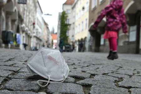 Corona crisis - lockdown - FFP2 mask lies on a street in Steyr, Austria, Europe