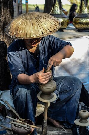 sculpting: Asian Sculpting Art from Hands working on pottery wheel ,hdr & retro style toned Stock Photo