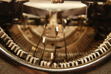 Letters of an old typewriter hitting the paper