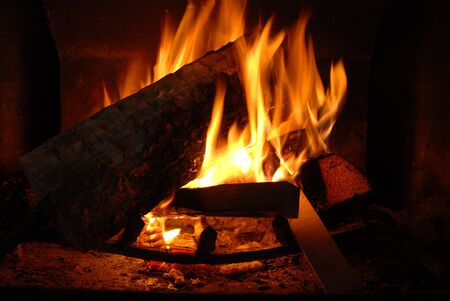 wood fire: Burning wood with beautiful flames in a fireplace.  Stock Photo