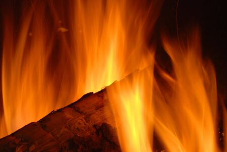 Burning wood with beautiful flames in a fireplace.  Stock Photo