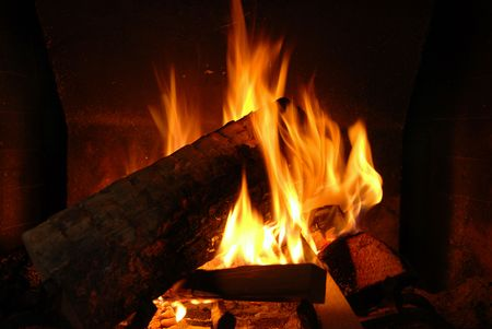 Burning wood with beautiful flames in a fireplace.  Stock Photo - 3850186