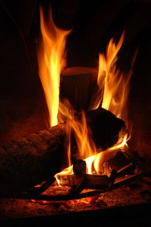 Burning wood with beautiful flames in a fireplace. Stock Photo - 3850182