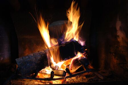 Burning wood with beautiful flames in a fireplace. Stock Photo - 3850198