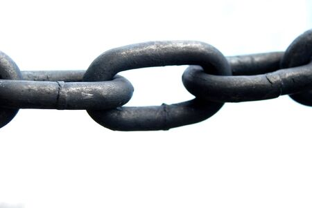 Detail of a iron chain with white background.