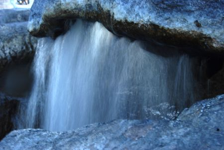 A mystic waterfall slashing on the rocks. Stock Photo