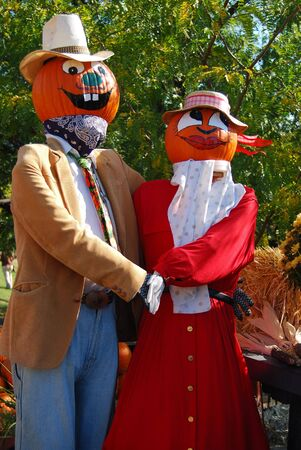 Dancing pumpkin puppets on a farmers market