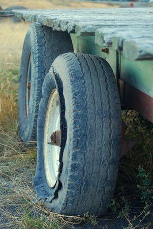 Old broken tractor hanger lying in a field