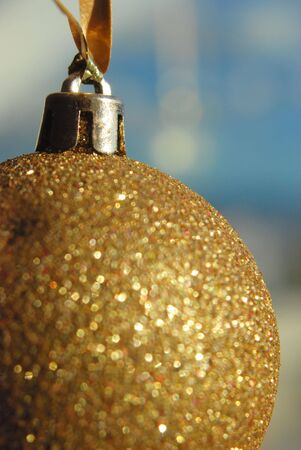 A golden ball hanging on a window Stok Fotoğraf
