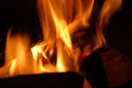 Burning wood with beautiful flames in a fireplace.  Stok Fotoğraf