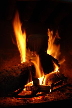 Burning wood with beautiful flames in a fireplace.  Stock Photo - 3962089