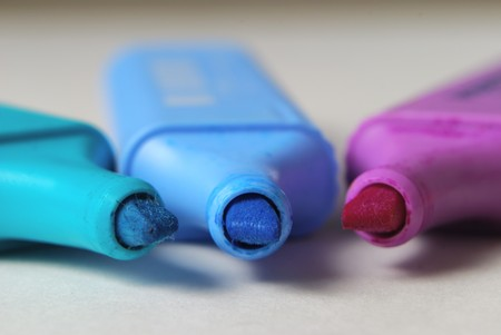 Markers in different colors lying on a desk Stock Photo