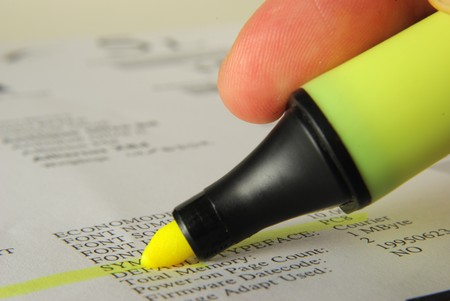 Yellow Highlighter and technical words on a paper