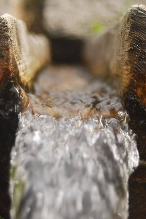 Refreshing cold water in a wooden spring.