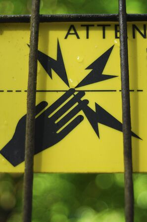 hazard: A sing saying: do not touch - high voltage fence.