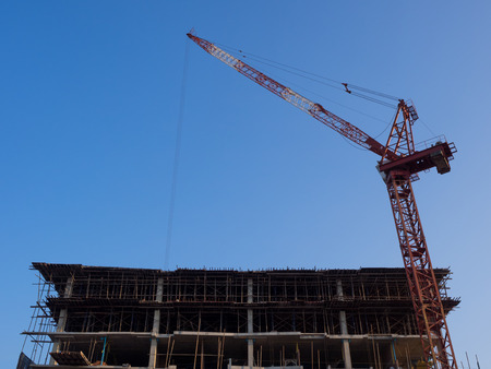 unfinished building: Construction Crane and Unfinished Building Stock Photo