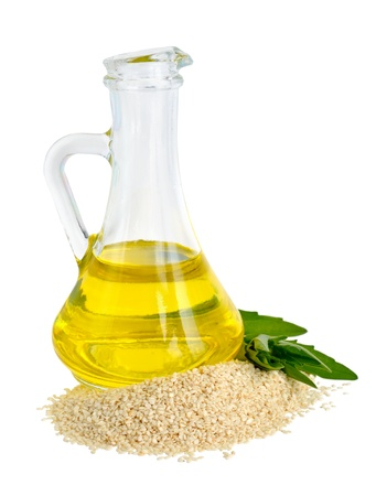 white sesame seeds: Sesame oil oil in a glass jug  Stock Photo