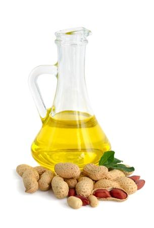 Peanut oil in a glass jug. Stock Photo