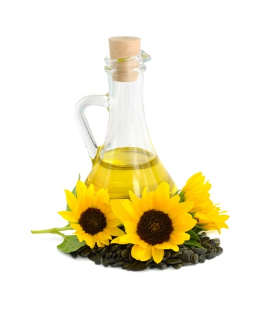 Decorative sunflowers with oil in glass jug. Isolated on a white background photo