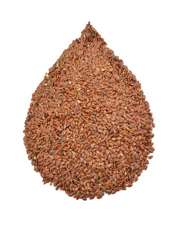 Flax seeds in are filled to a drop form. Isolated on white background. photo